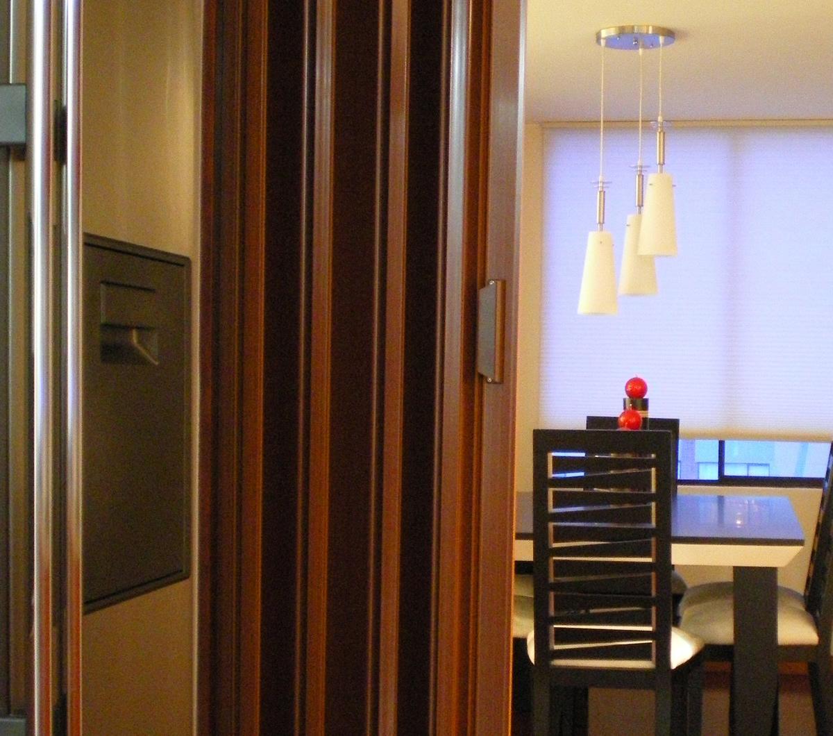 Cortiambientes persianas toldos y cortinas for Puertas plegables de madera