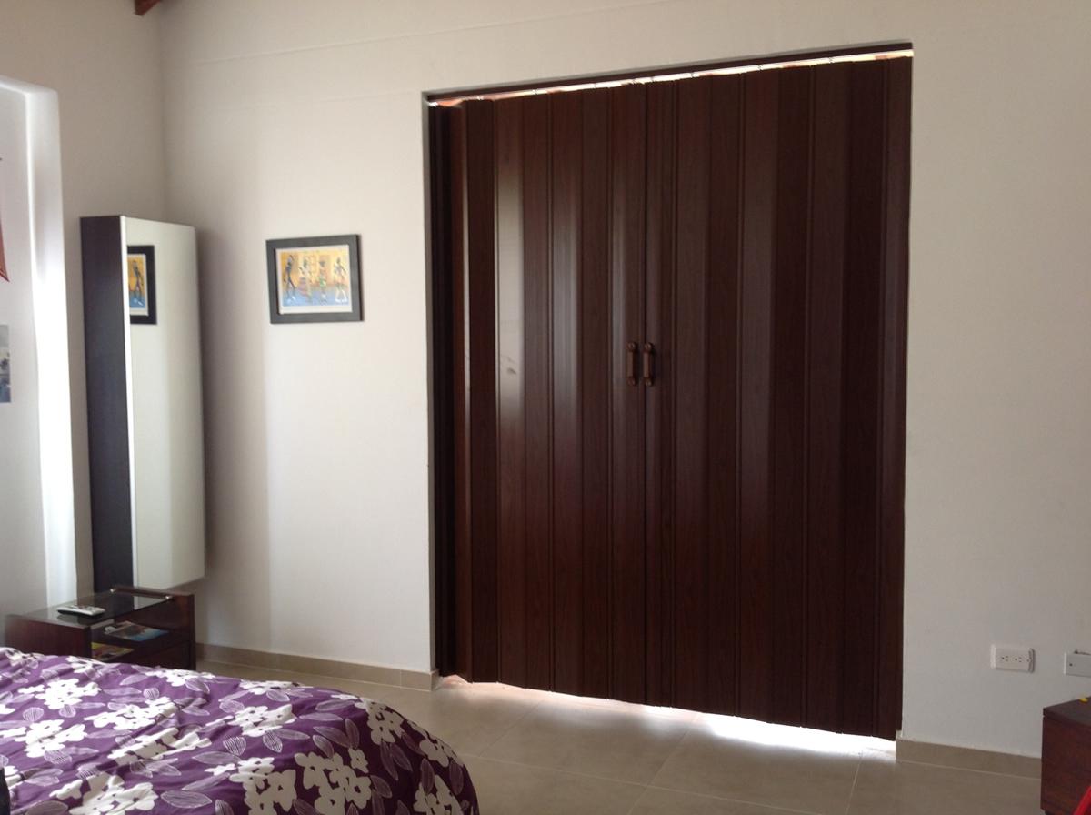 Cortiambientes persianas toldos y cortinas for Cortinas de madera para puertas